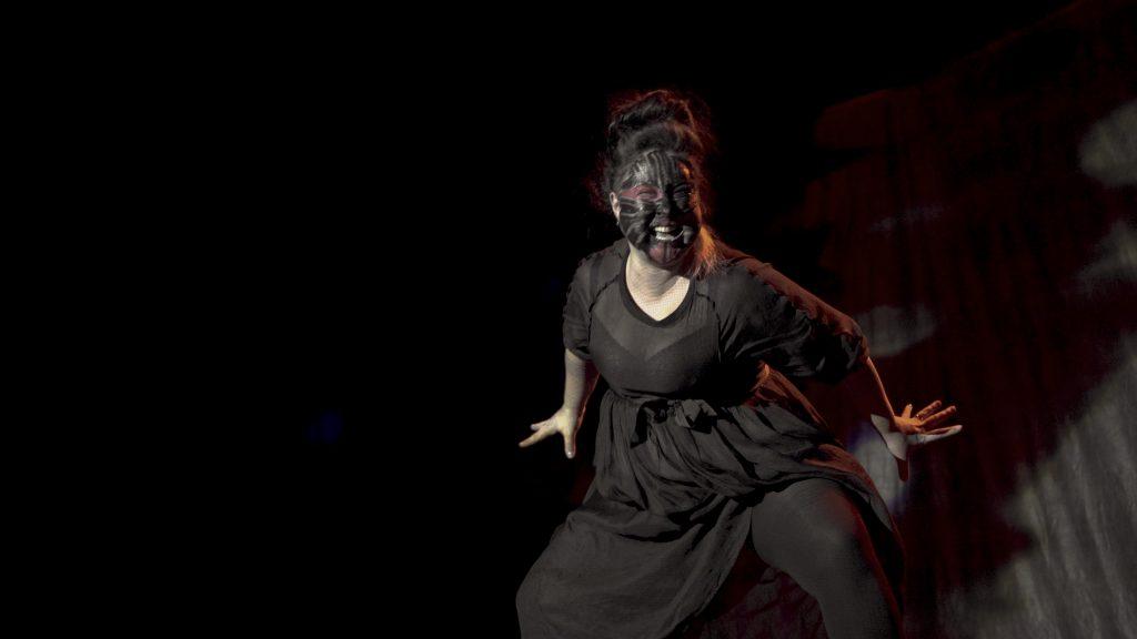 Laakkuluk emerges onstage as Uaerneeq dancer