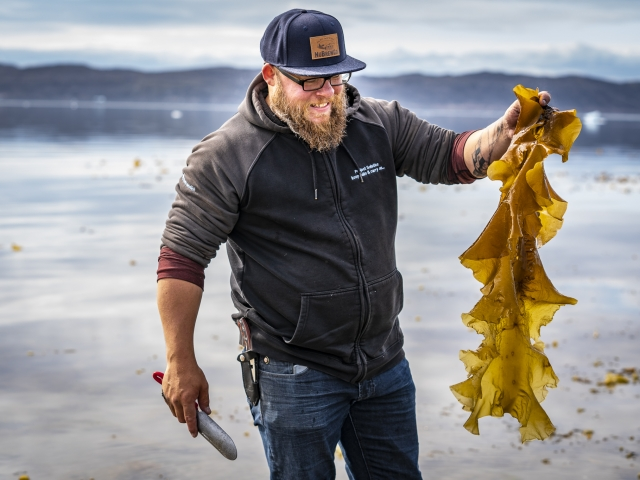 Justin from Uasau Soap, collecting seaweed
